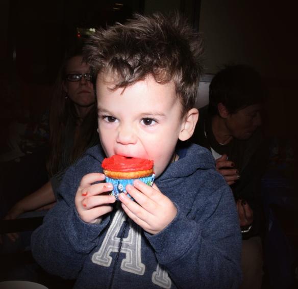 Beans enjoying his birthday cupcake!