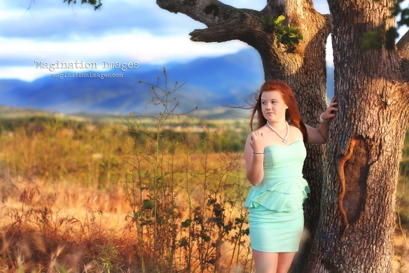 Redheaded girl on hill