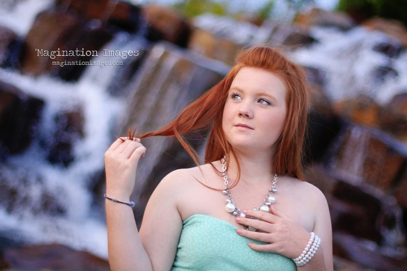 Red headed girl waterfall