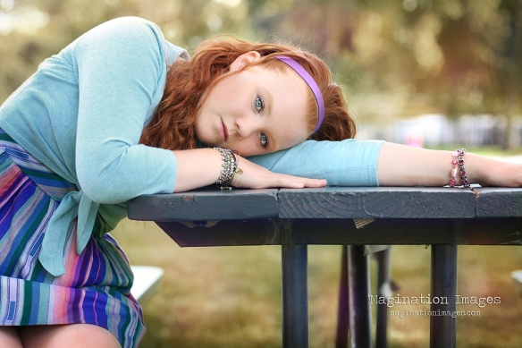 Red headed girl picnic table